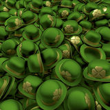 St Patricks Day Bowler Hats. Pool, heap, pile of green bowler hats with shiny, golden shamrocks on sides,3d rendering Royalty Free Stock Photo