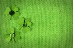 St Patricks Day burlap background with shamrocks Stock Photography