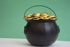 St. patricks day caldron with gold. Saint patricks day represented by gold in a caldron Stock Images