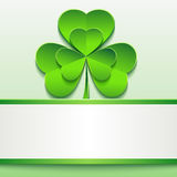 St. Patricks day card with green clover and paper Stock Images