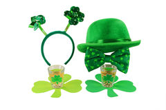 St  Patricks Day Celebration. Arrangement from St. Patricks Day decorations for woman and man, Shots glasses full with Irish whiskey over clover shaped coasters Stock Photos