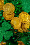 St. Patricks Day chocolate gold coins, beads and shamrocks Stock Images