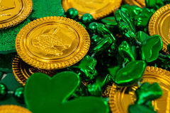 St. Patricks Day chocolate gold coins, beads and shamrocks Stock Photography