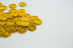 St. Patricks Day chocolate gold coins. On white background Stock Photo