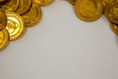 St. Patricks Day close-up of chocolate gold coins. On white background Royalty Free Stock Photo