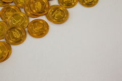 St. Patricks Day close-up of chocolate gold coins. On white background Stock Photos