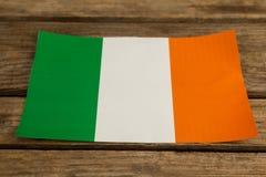 St. Patricks Day close-up of irish flag. On wooden background Royalty Free Stock Image