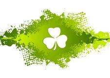 St. Patricks Day clover on green grunge blot background Royalty Free Stock Photos