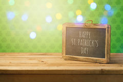 St. Patricks day concept with chalkboard on wooden table with bokeh lights Royalty Free Stock Image
