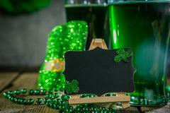 St. Patricks day concept - green beer and symbols. Rustic background Stock Photos