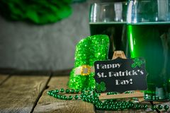 St. Patricks day concept - green beer and symbols. Rustic background Royalty Free Stock Photo