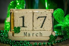 St. Patricks day concept - green beer and symbols. Wood calendar, rustic background Royalty Free Stock Images