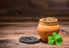 St Patricks day concept with pot full gold coins, horseshoe and royalty free stock images