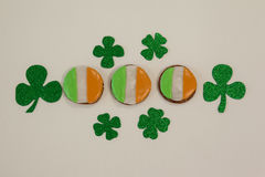 St. Patricks Day cookies decorated with irish flag surrounded with shamrocks. On white background Stock Image