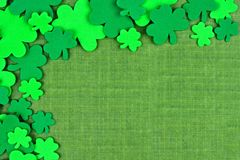 St Patricks Day corner border of shamrocks over green linen Stock Photography