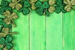 St Patricks Day corner border of shamrocks over green wood Stock Photo
