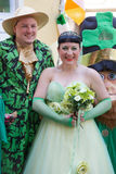 St Patricks Day couple. Candid portrait of funny happy couple dressed up in green bride and groom during Saint Patricks day; Brisbane, 15 March 2014 Stock Image