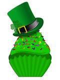 St Patricks Day Cupcake with Colorful Sprinkles. St Patricks Day Cupcake with Colorful Chocolate Chip Sprinkles and Leprechaun Hat Isolated on White Background Stock Images