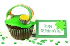St Patricks Day cupcake with greeting card Royalty Free Stock Image