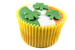 St patricks day cupcake with icing and shamrocks. Irish st patricks day cupcake with green, white and orange icing Royalty Free Stock Photo