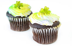 St Patricks Day Cupcakes. Two cupcakes decorated for St Patricks Day and isolated on a white background Royalty Free Stock Photography