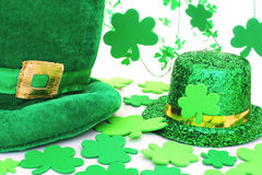 St Patricks Day decor. St Patrick's Day hats with shamrocks over white Stock Photo