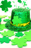 St Patricks Day decor. Shiny St Patricks Day hat with shamrocks over white Royalty Free Stock Images