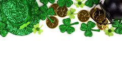 St Patricks Day decor corner border over white. St Patricks Day top border isolated on a white background. Above view with Pot of Gold, shamrocks and leprechaun Stock Photos