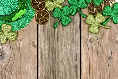 St Patricks Day decor top border over rustic wood Royalty Free Stock Photography