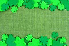 St Patricks Day double border of shamrocks over green linen Royalty Free Stock Photo