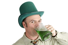 St Patricks Day Drinking. A handsome Irish American man drinking green beer on St. Patrick's Day.  Isolated on white Stock Photos