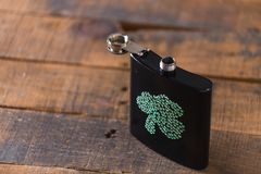 St. patricks day drinking flask. St. patricks day flask for drinking whiskey Stock Image