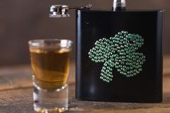 St. patricks day drinking flask. St. patricks day flask for drinking whiskey Royalty Free Stock Images