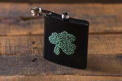 St. patricks day drinking flask. St. patricks day flask for drinking whiskey Stock Images