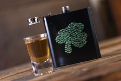 St. patricks day drinking flask. St. patricks day flask for drinking whiskey Royalty Free Stock Photo