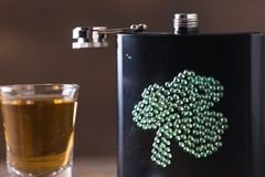 St. patricks day drinking flask. St. patricks day flask for drinking whiskey Stock Photo