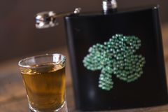 St. patricks day drinking flask. St. patricks day flask for drinking whiskey Stock Photography