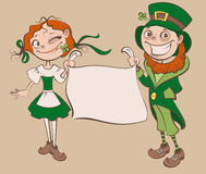 St. Patricks Day Festival. Young woman and man holding banner Stock Photo