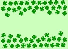 St Patricks Day festive background - double side border of green quatrefoils on the light green. St Patricks Day background, double side border of datk green stock photo