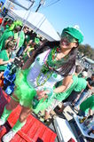 St. Patricks Day. Festive for the parade, woman dressed up in all green for the annual St. Patty's Day Parade in Dallas, Tx Royalty Free Stock Photography
