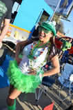St. Patricks Day. Festive for the parade, woman dressed up in all green for the annual St. Patty's Day Parade in Dallas, Tx Stock Photos