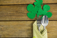St Patricks Day fork and spoon wrapped in napkin with shamrocks Royalty Free Stock Photo