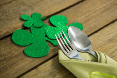 St Patricks Day fork and spoon wrapped in napkin with shamrocks Stock Image