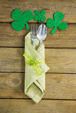 St Patricks Day fork and spoon wrapped in napkin with shamrocks Royalty Free Stock Photos
