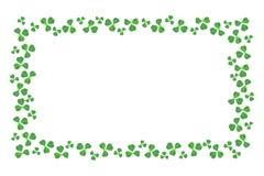 St Patricks Day frame edge of shamrocks over white royalty free stock images