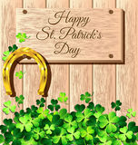 St. Patricks Day frame with gold horseshoe on wooden Royalty Free Stock Photos