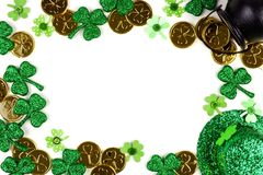St Patricks Day decor frame isolated on white. St Patricks Day frame isolated on a white background. Above view with Pot of Gold, shamrocks and leprechaun hat Royalty Free Stock Photo