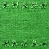 St Patricks Day frame of paper shamrocks on green burlap Royalty Free Stock Photos