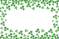 St Patricks Day frame of shamrocks over white Stock Images