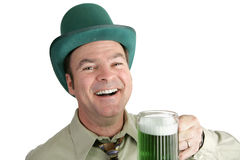 St Patricks Day Fun. A handsome Irish man enjoying green beer on St. Patrick's Day.  Isolated on white Stock Image